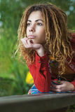 Pensive woman with dreadlocks closeup Stock Photography