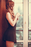 Pensive woman drinking hot coffee beverage at home Stock Photography