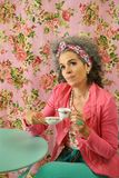 Pensive woman drinking tea or coffee royalty free stock images