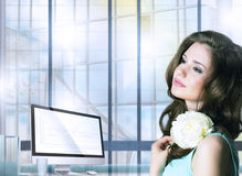 Pensive Woman with Flower in Office Space Stock Image