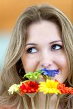 Pensive woman with flowers Royalty Free Stock Photos