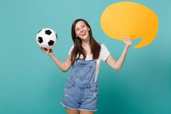 Pensive woman football fan cheer up support team with soccer ball, empty blank yellow Say cloud, speech bubble isolated. On blue turquoise background. People stock image