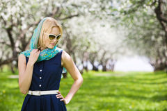 Pensive woman in garden Royalty Free Stock Images
