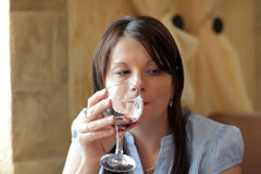 Pensive woman with glass of wine Royalty Free Stock Photos