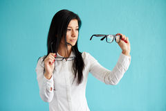 Pensive woman with glasses Stock Photography