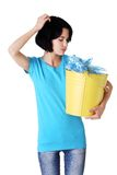 Pensive woman holding bucket of plastic rubbish Royalty Free Stock Photos