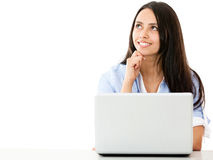 Pensive woman with a laptop Stock Images