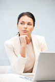 Pensive woman with laptop computer Royalty Free Stock Photo