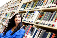 Pensive woman at the library Stock Images