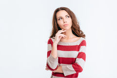 Pensive woman looking away at copyspace Stock Photo