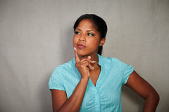 Pensive woman looking away while thinking Royalty Free Stock Photography