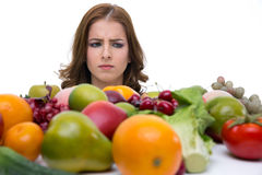 Pensive woman looking on the fruits Stock Image
