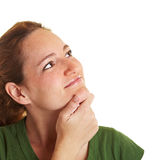 Pensive woman looking up Stock Photos