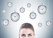 Pensive woman looking up, time management Royalty Free Stock Images
