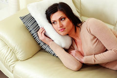 Pensive woman lying on the sofa Royalty Free Stock Images