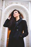 Pensive woman near beautiful entrance door Royalty Free Stock Photos