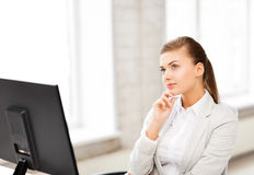 Pensive woman in office Royalty Free Stock Photography