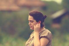 Pensive woman outdoor portrait Stock Photography