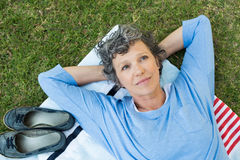 Pensive woman in park Royalty Free Stock Photos