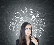 Pensive woman with a pen, internet search Royalty Free Stock Photo