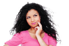 Pensive woman in pink blouse Stock Photography