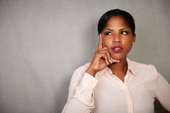Pensive woman planning with hand on chin Royalty Free Stock Images