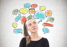 Pensive woman with a ponytail, speech bubbles Royalty Free Stock Photo