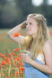Pensive  Woman  in poppy field Royalty Free Stock Photography