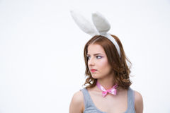 Pensive woman in rabbit ears looking away Royalty Free Stock Photos