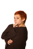 Pensive woman with red hair Royalty Free Stock Photography