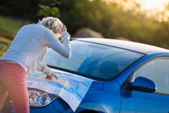 Pensive Woman on a Rural Scene Looking at a Map Royalty Free Stock Image
