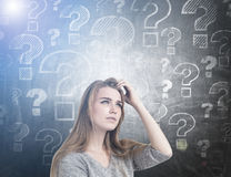 Pensive woman scratching head, questions, toned Royalty Free Stock Image
