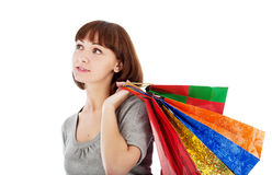 Pensive woman with shopping bags Royalty Free Stock Image