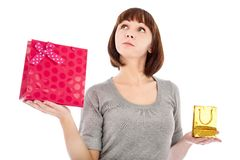 Pensive woman with shopping bags Stock Images