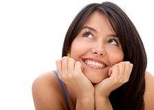 Pensive woman smiling Royalty Free Stock Photos