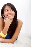 Pensive woman smiling Stock Photos