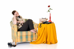 Pensive woman in sofa Stock Image