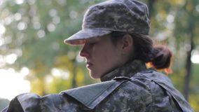 Pensive woman soldier stock footage