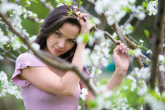 Pensive woman at spring stock photo