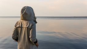 The pensive woman standing near the sea royalty free stock photos