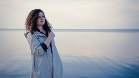The pensive woman standing near the sea royalty free stock images