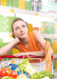 Pensive woman at store Royalty Free Stock Photo