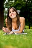 Pensive woman studying Royalty Free Stock Photos
