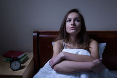 Pensive woman stying sleepless at night. Pensive woman stying sleepless in bed at night stock images