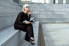 Pensive woman with a tablet. royalty free stock photo