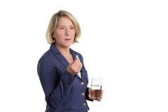 Pensive woman with tablet. And waterglass looking very doubtful, copy space, isolated Stock Image