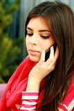 Pensive woman talking on the phone Royalty Free Stock Photo