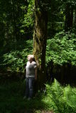Pensive woman in a thick green forest Royalty Free Stock Photo