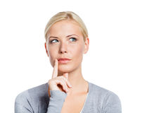Pensive woman touching her face Stock Photos