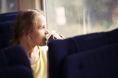 Pensive woman traveling by train Royalty Free Stock Image